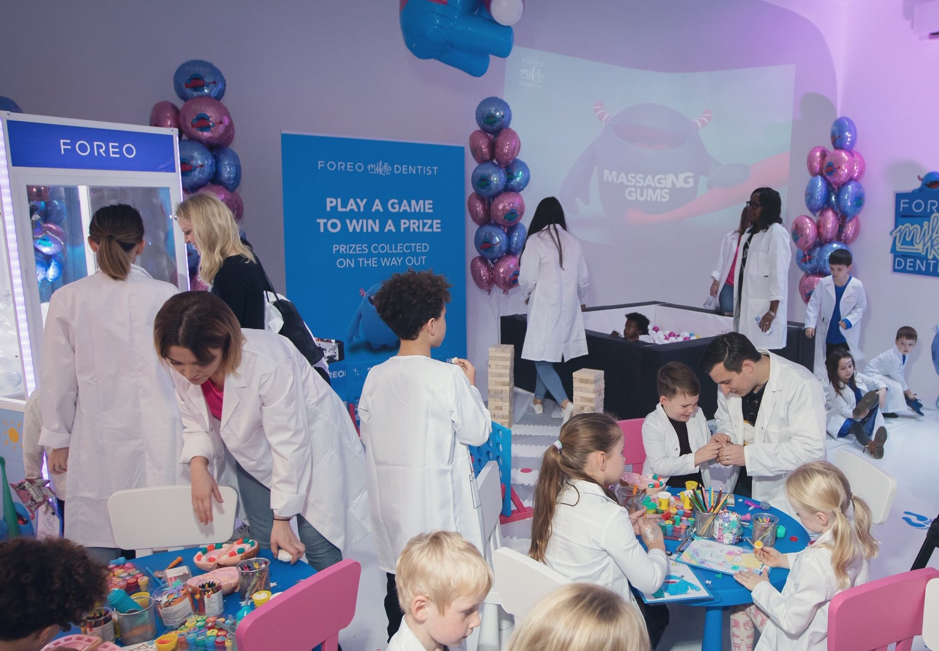 Playing with a Playdoh Dentist set at the FOREO Issa Mikro Event