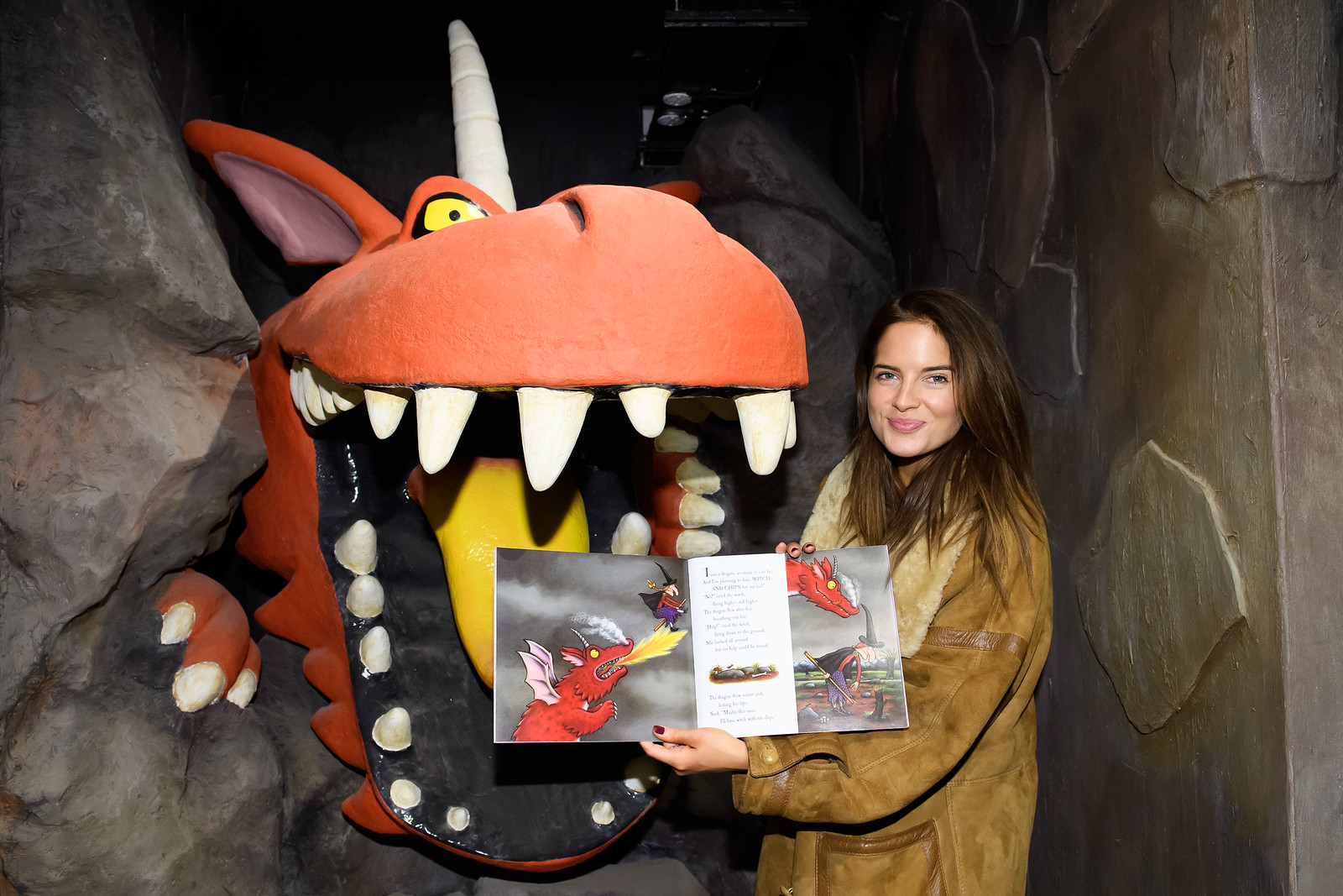 Binky Felsted compares the Dragon to the book's counterpart in Inside Room on the Broom - A Magical Journey - Image from INHOUSE IMAGES